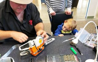 Repairing-a-toy-chainsaw